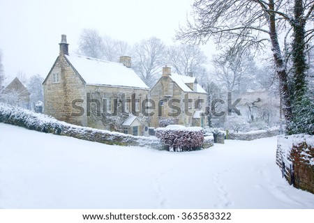 A snowy winter scene of a small hamlet in the heart of the Cotswolds, Gloucestershire, England, United Kingdom - stock photo