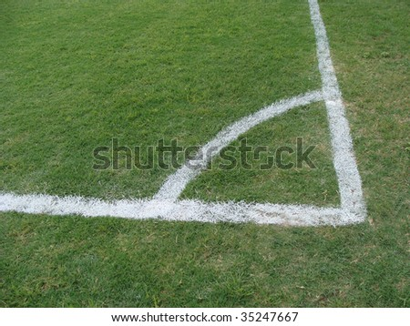 A soccer field corner painted in white