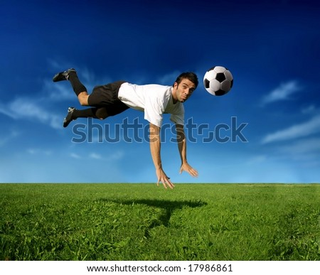 a soccer player in acrobatic - stock photo
