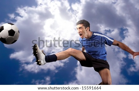 a soccer player in acrobatics - stock photo