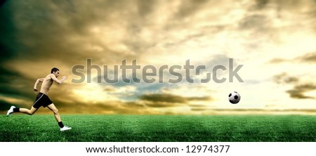 a soccer player run on the grass field - stock photo