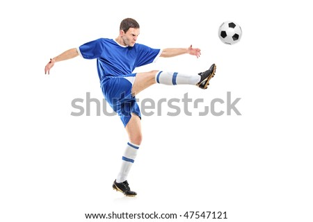 A soccer player shooting a ball isolated on white background