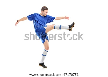A soccer player shooting isolated on white background - stock photo