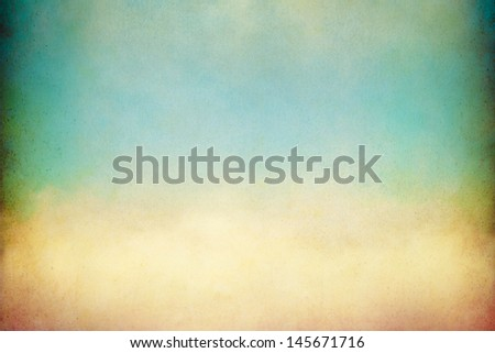 A soft, billowing cloud with vintage colors and textures.  Image displays a pleasing paper grain visible at 100 percent. - stock photo