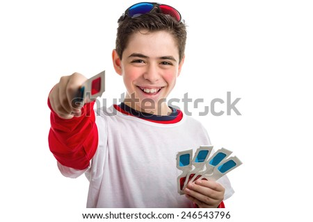 A Soft skinned Caucasian boy wears a pair of black 3D Cinema paper eyeglasses on his head with red and blue lenses and  offers a pair of white googles while holding four ones - stock photo