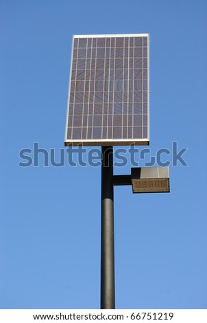 A solar panel and a street light