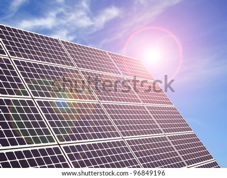 A solar panel with reflections of the sun - stock photo