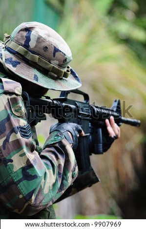 A soldier on high alert - stock photo