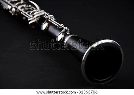 A soprano clarinet isolated against a black background in the  horizontal format with copy space.