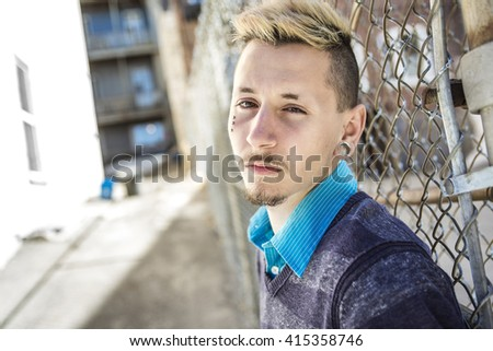 A Sorrowful young adult on the City Street - stock photo