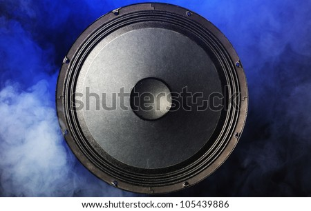a sound speaker surrounded by blue smoke - stock photo