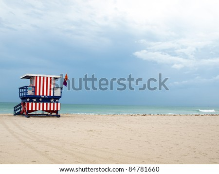 a South Beach styled lifeguard stand on a beach of Miami South Beach, Florida with copy and cropping space.