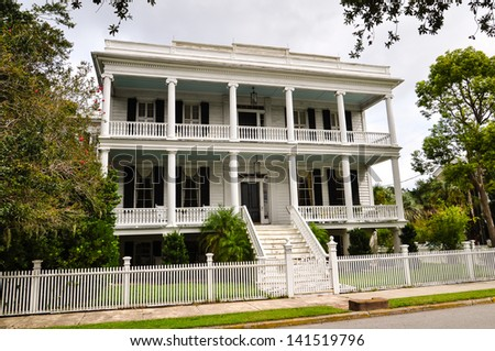 a southern style mansion of white wood - stock photo