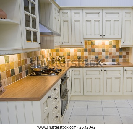A spacious modern kitchen - stock photo