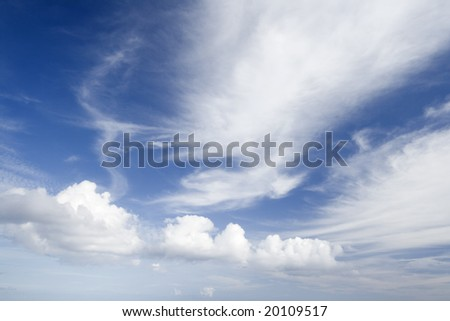 a spectacular blue sky with wonderful clouds - stock photo