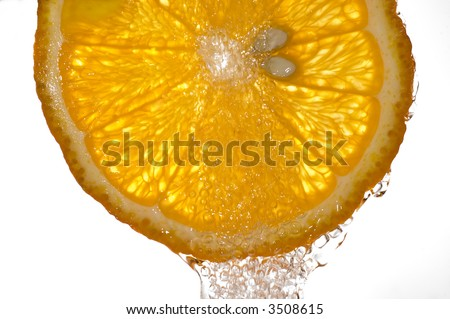 A splash of orange slice isolated on white background