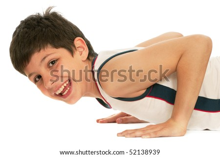 A sporty boy is pushing up; isolated on the white background - stock photo