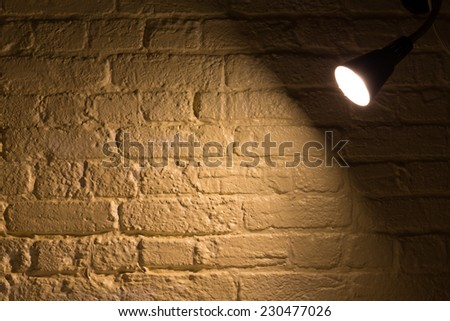 A spot light shining on a wall with copy space - stock photo
