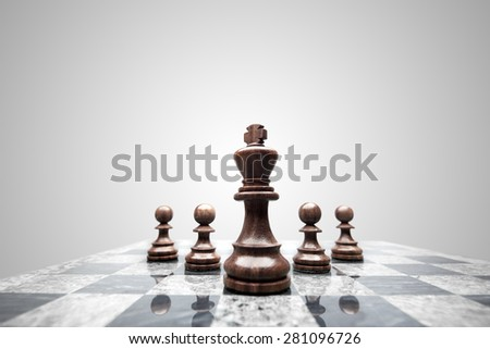 A squad of 5 chess pieces leaded by the king. - stock photo