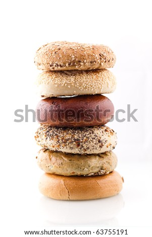 A stack of assorted bagels. - stock photo