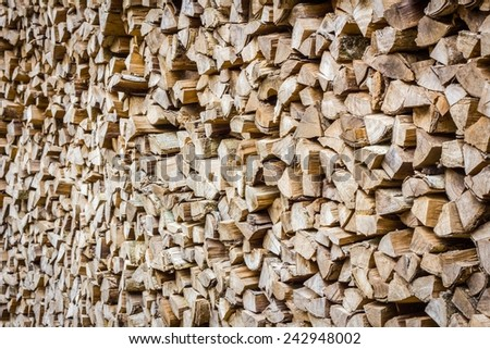 A stack of birch firewood - a natural horizontal background, perspective - stock photo