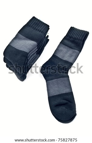 A stack of black socks isolated on a white. - stock photo