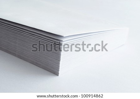 A stack of blank envelopes on white - stock photo