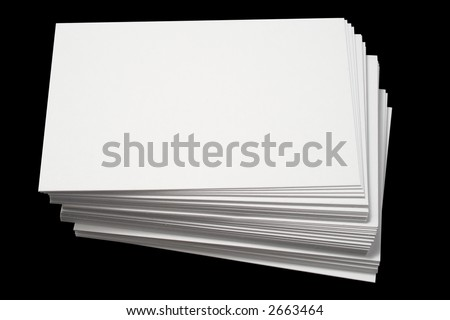 A stack of blank white business cards, isolated on a black background.