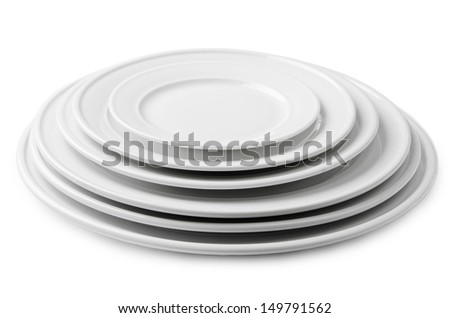 A stack of blank white plates of different sizes. Isolated on white background - stock photo
