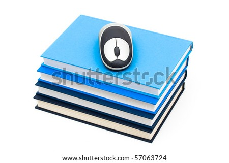 A stack of blue books with a wireless mouse on top, Online studying - stock photo