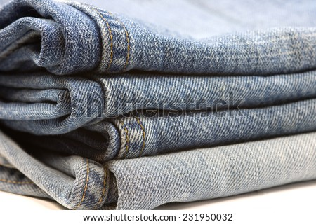 A stack of blue Denim jeans close-up - stock photo