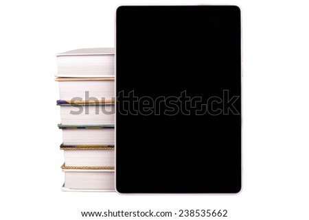 A stack of books and e-books on a white background - stock photo