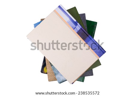 A stack of books shot from above on a white background - stock photo