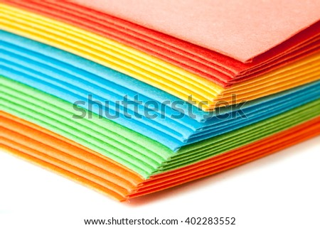 A stack of bright colored paper envelopes - stock photo