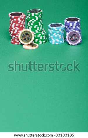 A stack of chips on a green playing a gambling table in a casino