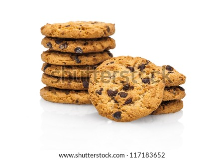 A stack of chocolate chip cookies isolated on a white background. - stock photo
