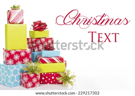 A stack of Christmas presents with an isolated white background - stock photo