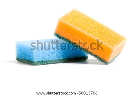 A stack of cleaning sponges with two scrubbing sides