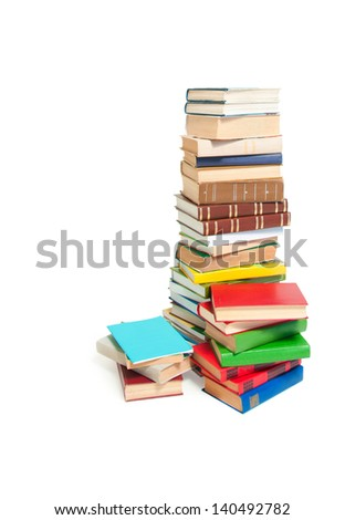 A stack of colorful books and magazines isolated on white background.