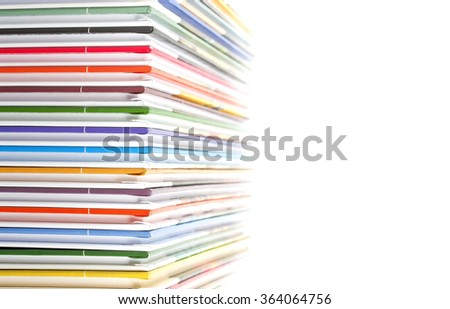 a stack of colorful books on white - stock photo