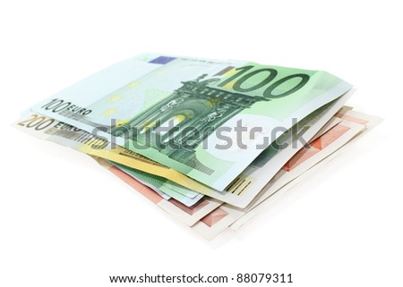 a stack of Euro notes on a white background