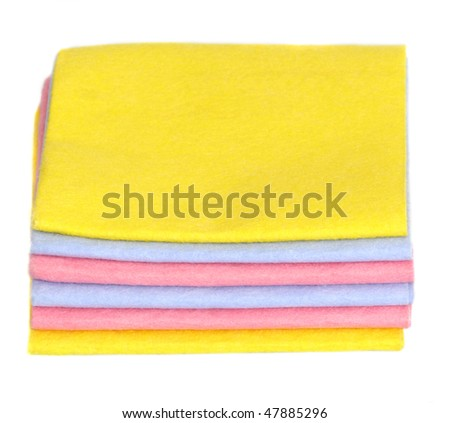A stack of fabric napkins for household isolated isolated on white - stock photo