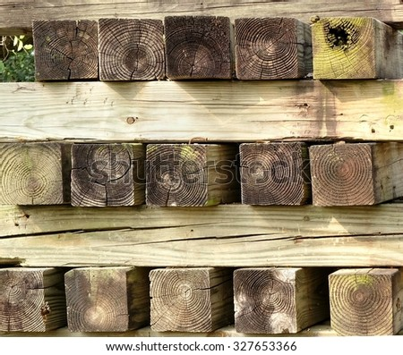 A stack of four by four inches lumber with growth rings  - stock photo