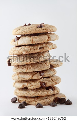 A Stack of Freshly Baked Chocolate Chip Cookies Isolated on White - stock photo