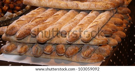 A Stack of Freshly Baked French Stick Loaves.