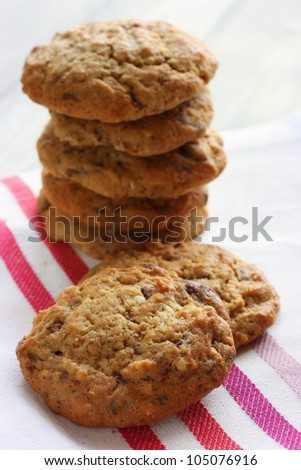 A stack of Homemade chocolate, nut and oat cookies - stock photo