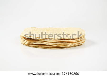 A stack of homemade tortillas on white background - stock photo