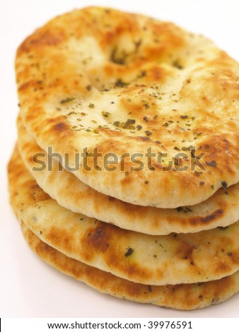 a stack of indian naan bread