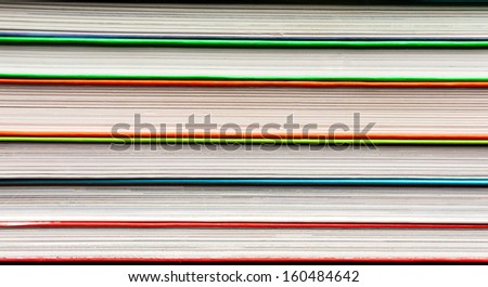 a stack of multicolored books  - stock photo