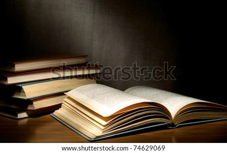 A stack of old books on the table - stock photo